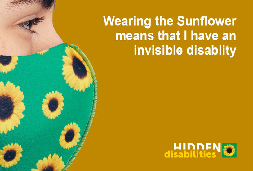 Person wearing Sunflower mask with text 'Wearing the Sunflower means that I have an invisible disability